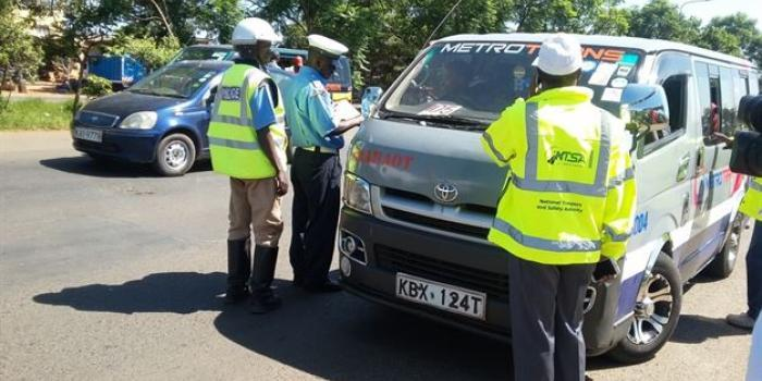 NTSA officers inspecting a vehicle in collaboration with traffic officers